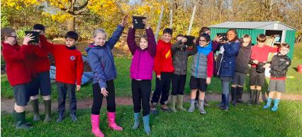 Cutteslowe school children plant 100 tree seeds